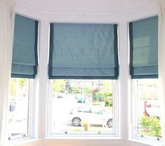 Ideas for dressing a traditional bay window.  Instead of curtains, install roman blinds.  Handmade roman blinds in blue silk in an Edinburgh bay window by Catherine Lepreux Interiors #baywindow #romanblinds #awkwardwindow