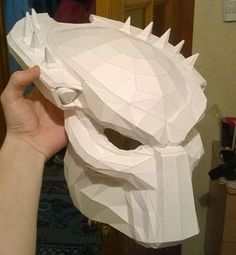 This papercraft is a life sizePredator Mask, created by Alexander Pashin.The size of finished model is about 389 (H) x 300 (W) x 271 (D) mm. You can down
