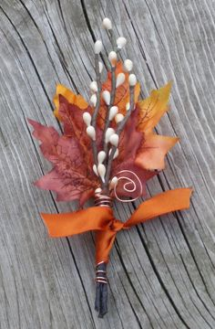 Fall Wedding Boutonniere Maple Twigs by TellableDesign It is wrapped with copper colored wire and a large bittersweet satin ribbon, a copper swirl peeks out for a little added shine.