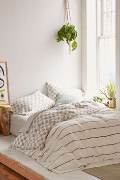 3 // If you have a smaller and low bed, a large duvet touching the floor can give quite a cozy feeling. This image is from Urban Outfitters where the duvet cover is from.