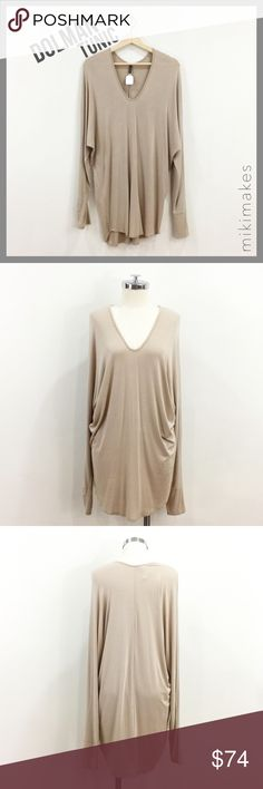 🆕 RILLER & FOUNT • nude tan dolman sleeve tunic • Nude / tan long dolman sleeve top • Tunic length and loose body • Deep v-neck • Super soft micro modal  93% micro modal 7% spandex Dry clean only Made in the USA  Please see size chart in Riller and Fount capsule listing at the top for approximate measurements.  Items vary depending on cut, but all items have stretch.    @mikimakes • Feel free to ask any questions • Sorry, no trades Riller & Fount Tops Tees - Long Sleeve