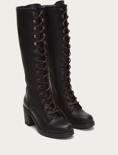 A work boot for late night warehouse parties or all-night creative sessions. The washed and oiled leather of this imposing, lace-up knee-high gets even better with wear. Distinctive details include raw leather laces, Double F hooks, and hand-burnishing throughout. Platform sole, stacked heel, street smart attitude.