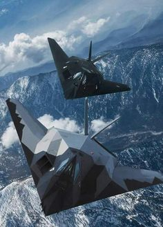 Nighthawk - Stealth attack aircraft - Top view of angular aircraft banking left while flying over mountains in Nevada in United States Air Force, Lockheed Corporation, First flight 18 June Retired 22 April Us Military Aircraft, Military Jets, Military Weapons, Air Fighter, Fighter Pilot, Fighter Jets, Stealth Aircraft, Fighter Aircraft, Avion Jet