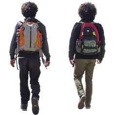 Two boys walking to school with brightly colored backpacks.