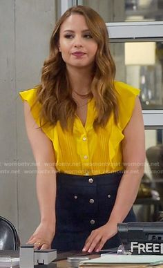 Sofia's yellow ruffled top and button front skirt on Young and Hungry.  Outfit Details: https://wornontv.net/58769/ #YoungandHungry