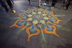 Artist Creates Incredibly Intricate And Colorful Sand Paintings Using His Hands - DesignTAXI.com