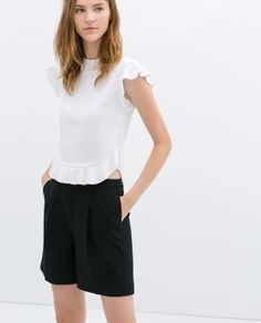 $29.90 not on sale. But very cute. ZARA - WOMAN - TOP WITH FRILLY SLEEVE