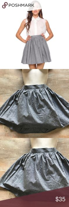 """NWOT American Apparel Full Woven Chambray Skirt In perfect shape. From a smoke free home. Elastic waistband in the back of skirt. Total length 17"""" American Apparel Skirts Mini"""