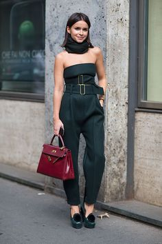 Milan Fashion Week spring 2014, Street style. Miroslava Duma in black Calvin Klein Collection jumpsuit with big buckled belts, black scarf, platform heels and burgundy Hérmes bag.