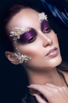 Dramatic avant garde purple eye makeup. Love the pretty crystals over the eye brows and cheeks.
