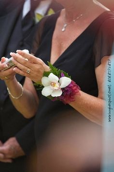 A nice touch for mom or mom in law, a sturdy orchid, frees up the hands for the all important snapshot!
