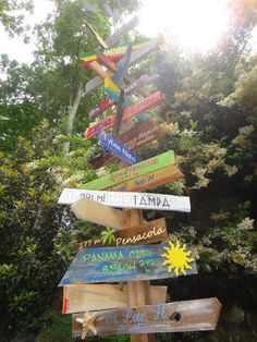 Customized Directional Sign Wooden Mile Marker by TheTrashySide