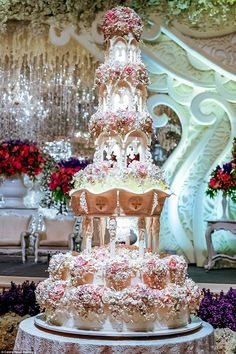 This church tower cake is held up by intricate pillars and it even features a mini chandel...
