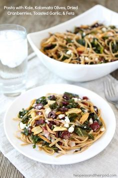 Pasta with Kale, Kalamata Olives, Dried Cranberries, Toasted Garlic, & Feta from twopeasandtheirpod.com One of our favorite weeknight pasta recipes!