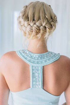 Halo braid: All the way up and all the way glam – this braided crown is a great style for dancing the night away. | Photo by Corbin Gurkin | See more hairstyles for long hair here: http://www.mywedding.com/articles/10-wedding-hairstyles-for-long-hair/