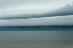 Stock photo of Tropical storm clouds over the Gulf of Mexico by goodnessgrace Blue Rain, Storm Clouds, Gulf Of Mexico, Sea Glass, Tropical, Cottage, The Unit, Stock Photos, Mountains