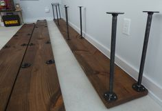 Assembly in process. The base is in position and lower pipes with flanges placed on flanges already attached. Contemporary Bookcase, Iron Pipe, Pipes, Industrial, Base, Wood, Woodwind Instrument, Timber Wood, Industrial Music