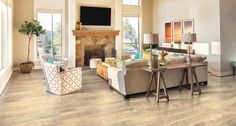 Southport Oak natural laminate floor. Beige oak wood finish, 10mm 1-strip plank laminate flooring, easy to install and covered by PERGO's lifetime warranty.