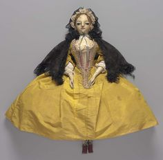 Doll in yellow taffeta dress. English 18.th Century - The Elizabeth Day McCormick Collection