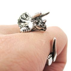 - Details - Sizing - Shipping A realistic Triceratops shaped animal ring in shiny silver! It is designed to look like you have a miniature Triceratops wrapped around your finger with its arms and tail