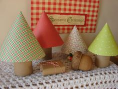 Tree cones..made with printed paper and toliet paper rolls. I like the smaller one. It would be cool in my gnome village