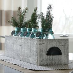 We made a rustic centerpiece out of pallet wood!  I love the way it looks for the post-holiday winter decor!