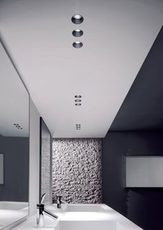 Bathroom in nice shades of white and grey, recessed lighting by Oty Light _