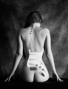 ***.. my husband always said.... guitars are refered to as she...because they are shaped like women.. holding one is like holding a woman.