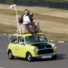 Mr. Bean and his car, a British Leyland Mini 1000. Armchair optional.
