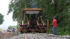 The R&GVRRM's Jackson tamper takes on the task of tamping and leveling portions of the freshly ballasted siding being built west of the Livonia, Avon & Lakeville to store the museum's ex-New York Central 'Empire State Express' train set.