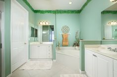 Inviting master bath with dual sinks, tub and shower