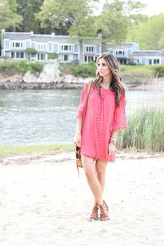 This coral fringe dress with off-shoulder detail is perfect for summer!