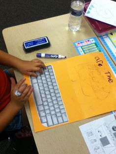 "word work... It's a file folder laptop!  The kids write the words then practice ""typing"" them on their own laptop!"