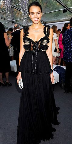 Also at the Glamour Women of the Year Awards and donning Alexander McQueen, Jessica Alba is a vision in a beautiful, black, tiered gown with a studded white clutch by the designer. She pulls her hair back in a chic bun and adorns her neck with a silver necklace.
