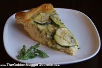 As a young girl, I have many fond memories of sitting on our back deck eating a slice of my Mom's zucchini quiche and sipping on an ice cold glace of homemade iced tea. This recipe is a pot-luck pleaser that is a cinch to make and the finished product looks impressive.    This is a great recipe for little helpers because the crust is made out of a refrigerated package of Pillsbury croissants. So while you are slicing and sauteing, your little helper can roll out the dough and piece together into the pie dish.