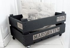 rolling pallet bin: just add wheels to a wood crate and paint