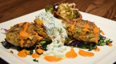 Lentil, Quinoa and Carrot Cakes with harissa and tzatziki sauces, roasted Romanesco and sautéed kale and radicchio | Green Valley Grill | Greebsboro, NC