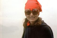 Jackie...Post-White House...With Her Trademark Round Sunglasses & Head Scarf...