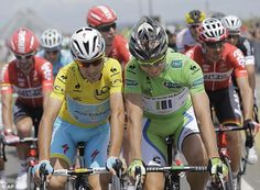 Playing around: Italy's Vincenzo Nibali, wearing the overall leader's yellow jersey, and Peter Sagan of Slovakia ride shoulder-to-shoulder