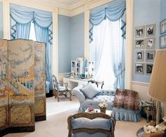 Jacqueline Kennedy's White House dressing room. Cinderella blue, mouldings and millwork, window treatments, Chinoiserie folding screen, personal photos, tufted and skirted chez, leopard throw - perfection.