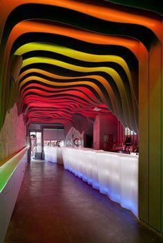 A fluorescent cave. / É Prà Poncha in Porto, Portugal. Designed by António Fernandez.