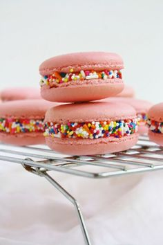 Pink birthday macarons dipped in colorful rainbow sprinkles