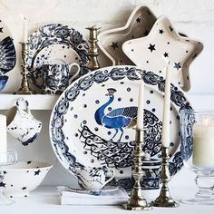 Our glamorous Peacock pattern is a densely-decorated and deep-hued showstopper, brand new for autumn. Look out for the platter featuring the flamboyant bird and lots of feathers – this is our most complex and time-consuming piece of decorating. @emma_bridgewater #CountryLivingTakeover #emmabridgewater #pottery #blue #peacock