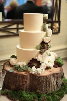 Gorgeous Rustic All White Cake with Sage and White Flowers on a Tree Stump with Moss #wedding #cake