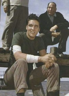 Handsome Guy Sitting There  Elvis In King Creole  During Rehearsals , On Location March 4,1958  in New Orleans, With Mr Hal Wallis In Background.