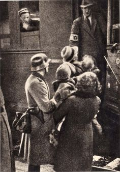 Poland, Jews boarding a train under the supervisio​n of a German soldier.