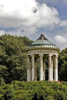 The Monopteros in the Englischer Garten in Munich, Germany, is a famous structure situated directly south of the chinese tower and directly north of the city center. The Monopteros is also known for hosting many of the city's drug addicts. Garden Pavilion, Palace Garden, Church Architecture, Historical Architecture, Garden Structures, Outdoor Structures, Pagoda Temple, Gazebo, Tiny House Community