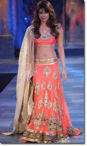 Coral and gold lehenga by Manish Malhotra modelled by Priyanka Chopra