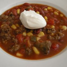 Taco Soup - Does not need chili peppers if you use 1 can Rotel  tomatoes & 1 can chopped tomatoes.  I omitted tomato sauce & peppers - used Rotel and it was plenty hot.