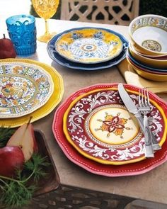 Perk up the party (outdoors or inside) with brightly colored, dishwasher-safe melamine dinnerware. Solid-color pieces have Baroque-style detailing; choose color below. Patterned dinnerware available in Benidorm, Malaga, or Rooster (shown clockwise from top); choose below. Imported.